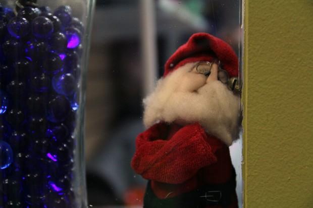 A Santa doll inside a window on Mission Street.