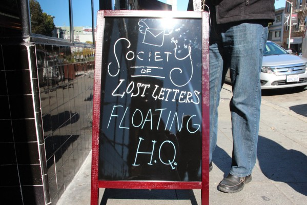 A sign outside Viracocha alerts passersby to the Valentine's Day Love Letter Scavenger Hunt.