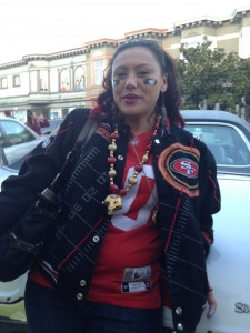 A woman named Asia steps away from the block party on Harrison Street.