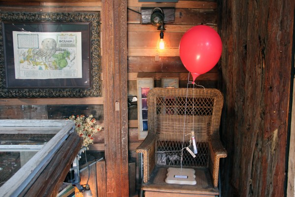 Inside Viracocha, a red balloon attached to a bottle with a letter inside and a key