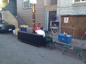 Fans watching the game in an alley near 24th Street.