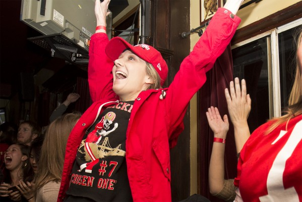A woman at Elixir celebrates the 49ers' comeback. (Photo by Marta Franco)