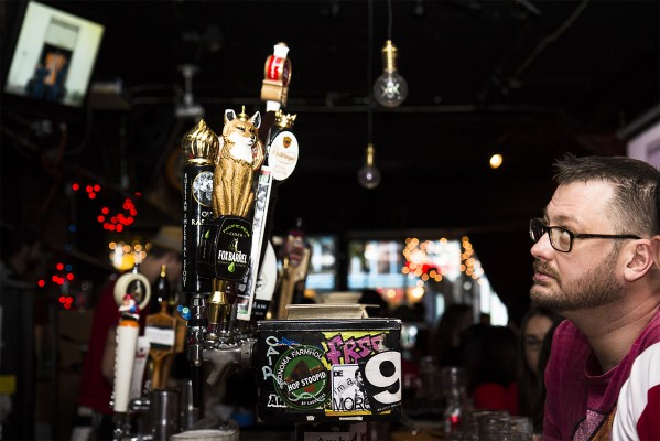 """A man watches the game at Delirium, where, according to bartender Mike Mutti, the day was """"a bit slow."""" (Photo by Marta Franco)"""