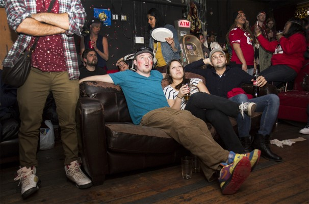 Luke Helming and friends relax on a couch at Gestalt. Helming, a Boston native, supports the 49ers. (Photo by Marta Franco)