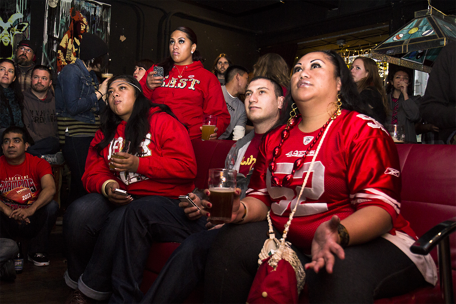 """Vernice Tafao and her friends watch the game at Gestalt. """"For me, this is not just a game,"""" she said. """"It's tradition. It's like a treasure."""" (Photo by Marta Franco)"""
