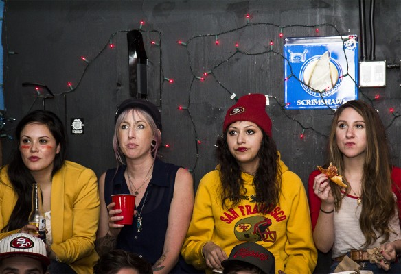 Four women watch the game at Gestalt on 16th Street. (Photo by Marta Franco)