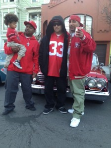 Yoyo (right) celebrates with friends on Harrison Street.
