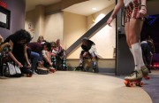 People tying up their skates at the Roller Disco Friday night. The party was for SF Indiefest.