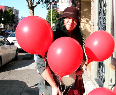Nunes, holding balloons, stops at every store that helped her.