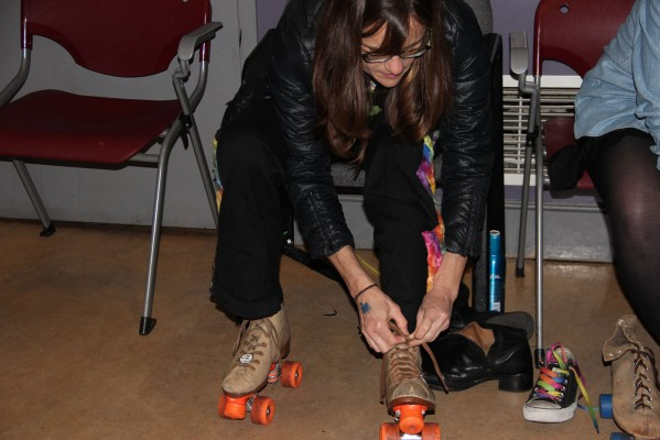 Susan Corkhill puts on her skates Friday night at the Roller Disco.