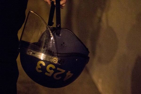 Helmets were carried by police officers on Mission Street. (Photo by Lauren Kate Rosenblum)