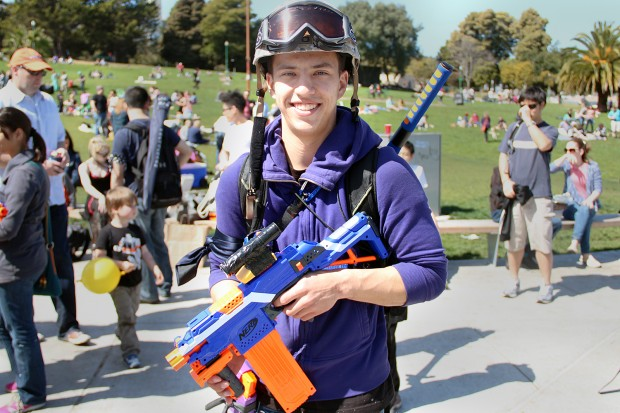 A human prepares for the Humans vs. Zombies Nerf War in Dolores Park Saturday.