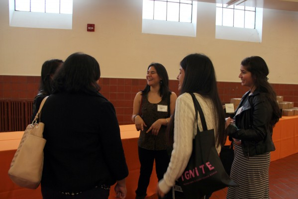 Sofia Campos, 23, talks with young women interested in politics at Mission High School.