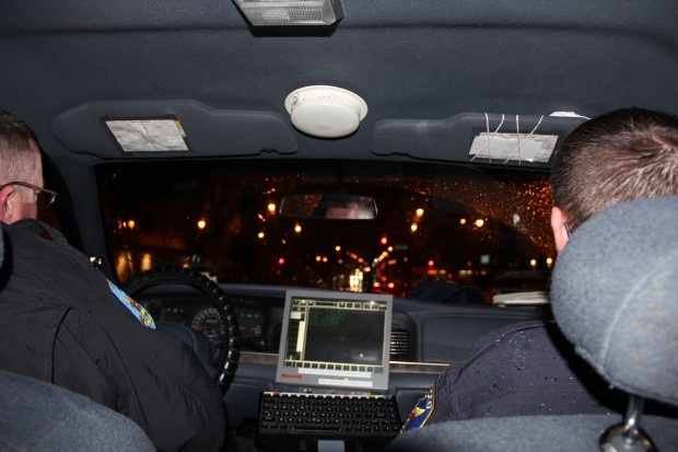 In the back of a Mission patrol car with Officer Davis and Officer Radford. Photo by Carly Nairn.