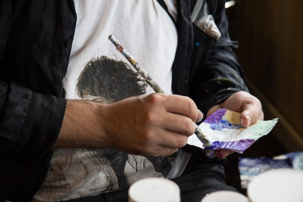 Lovins said that both locals and tourists buy his painted napkin art.