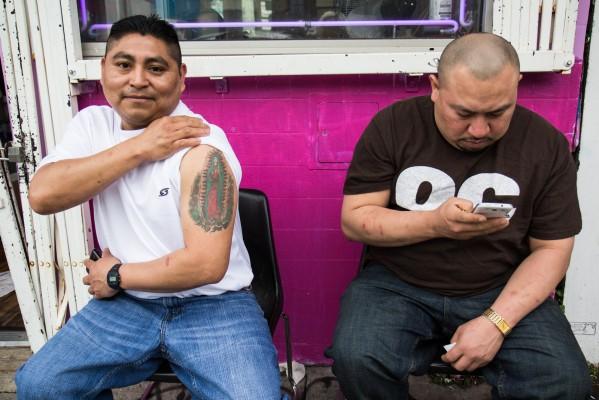 Octavio Nik shows off his tattoo.