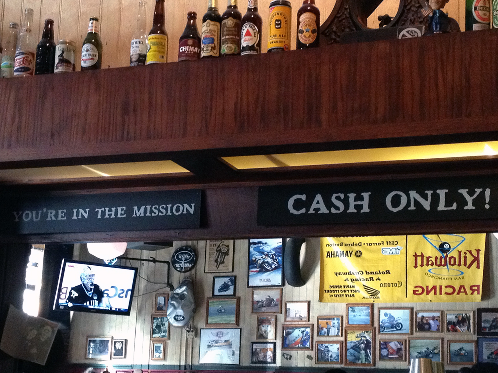 """A sign in Kilowatt on 16th Street reads """"You're in the Mission; Cash Only."""""""
