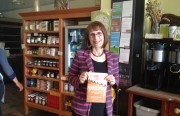 """Wenonah Hauter with her new book, """"Foodopoly,"""" at Mission Pie. Photo by Carly Nairn."""