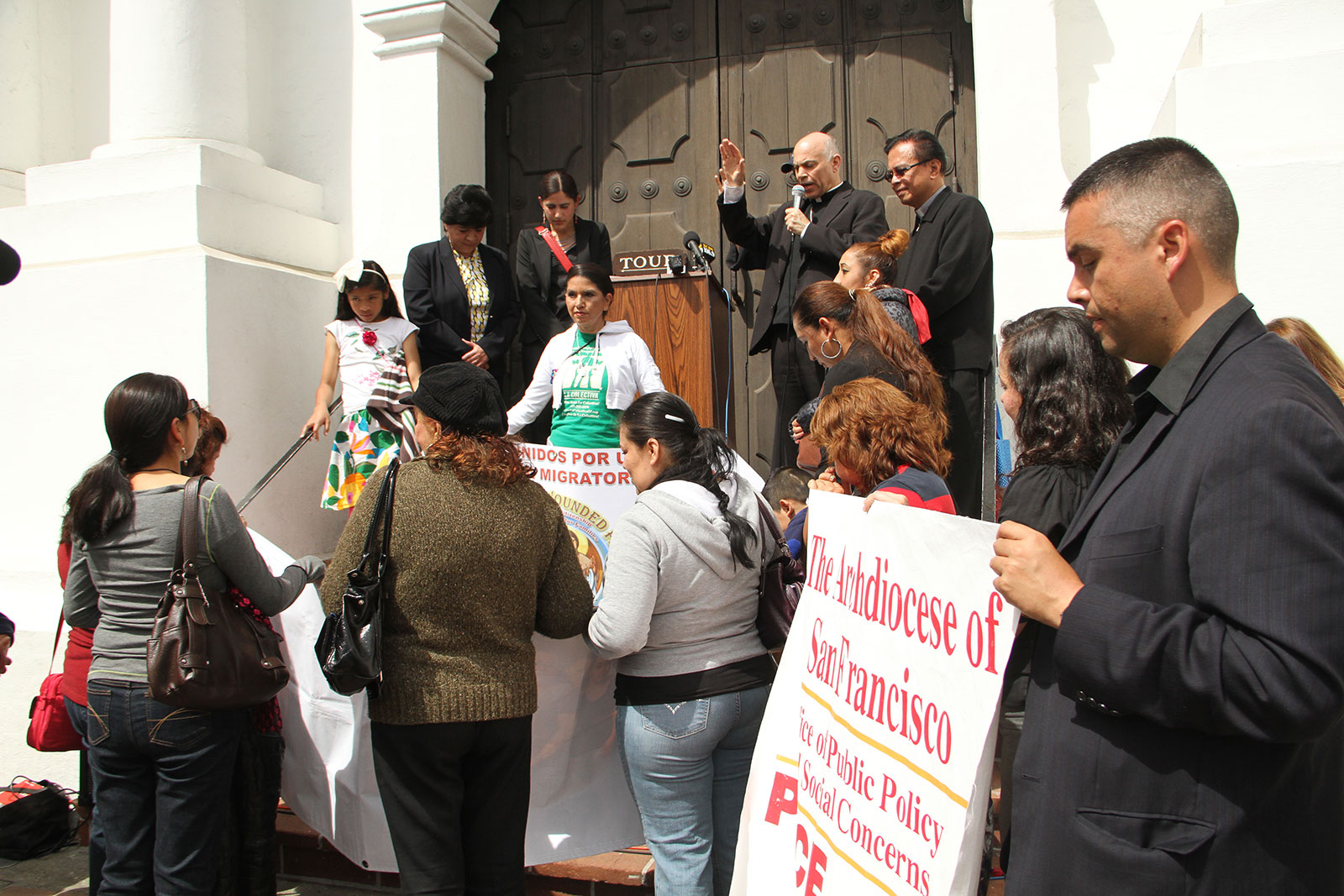 San Francisco Salvatore Cordileone gives a blessing to a crowd of immigration reform activists, May 13. Photo by Tay Wiles.