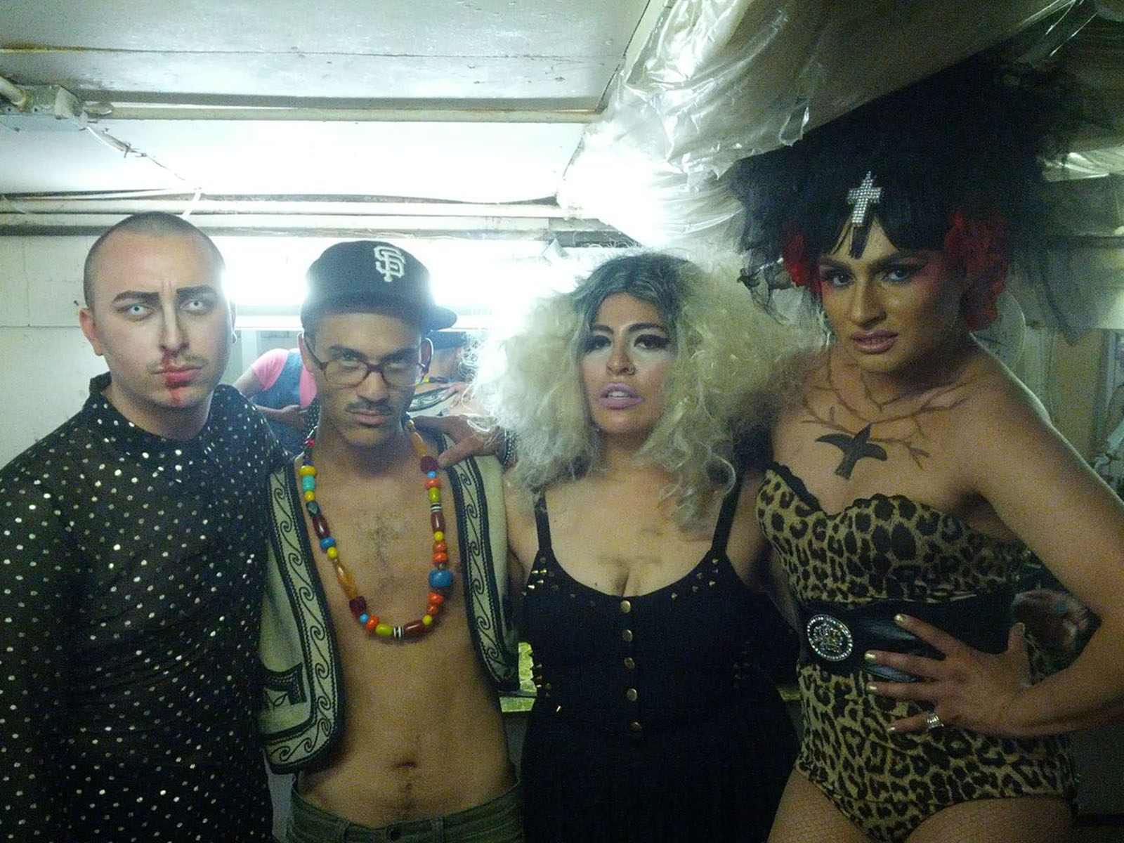 In the dressing room at Esta Noche: (left to right) Vain Hein, Tyler Holmes, San Cha of performance art group Daddies Plastik; and Persia at a fundraiser at Esta Noche May 18.