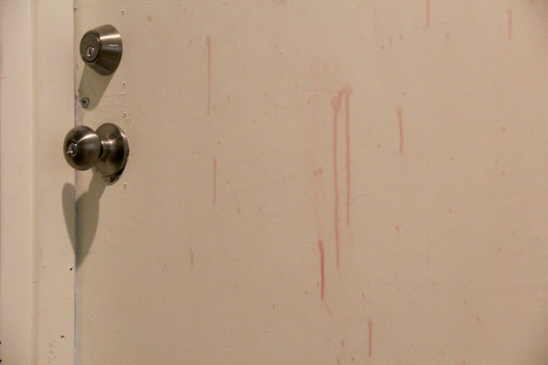 Yes, this is blood. But it's fake blood. One 20mission resident filmed a clown horror movie in one of the rooms. Fake blood was rampant and it splattered onto the door right across the hallway.