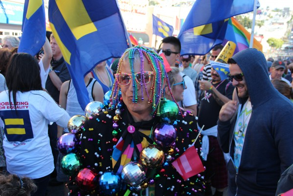 In beads and baubles, Bruce Beaudette danced among a crowd of Human Rights Campaign supporters.