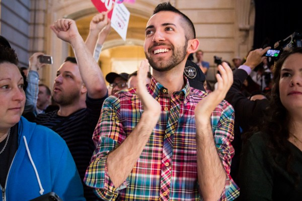 Jesse Castaneda celebrates the ruling on DOMA. Photo by Marta Franco.