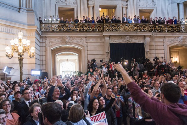 Moments before the Prop. 8 ruling was announced, a large crowd gathered inside City Hall. Photo by Marta Franco.