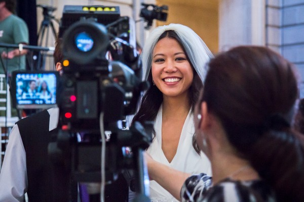 Jenny Chang with her girlfriend, being interviewed by Telemundo. Photo by Marta Franco.
