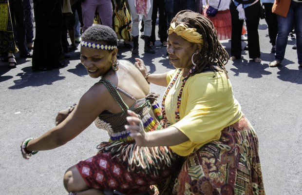 A festival attendee accepts the challenge and joins with a dancer of the Chinyakare Ensemble.