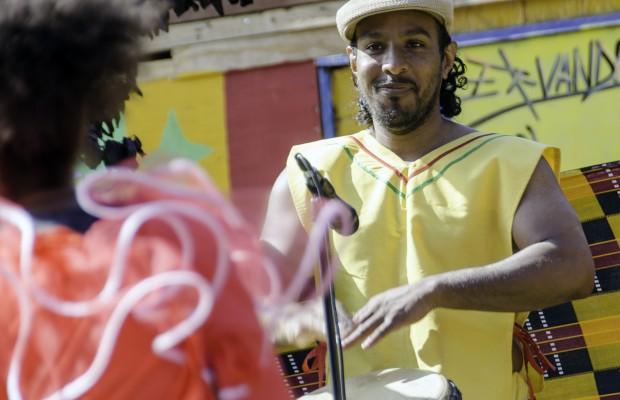 A drummer of the Musanga ensemble appreciates the dancers he accompanies.