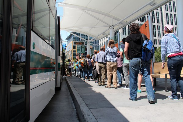 Commuters line up at the Temporary Transbay Terminal to catch a bus to the East Bay.