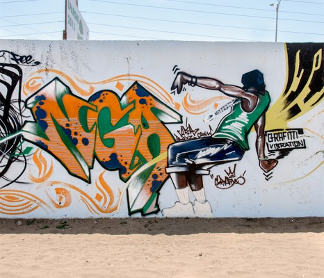 """Grafixx's finished mural, the word """"nga"""" (you) and the perso."""