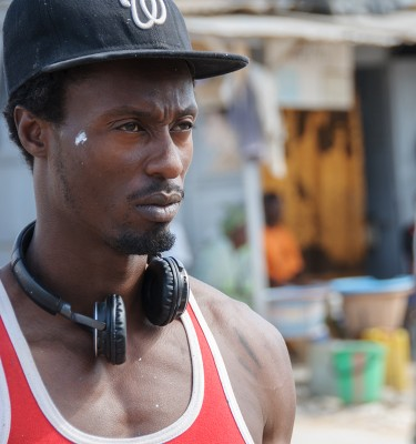Festigraff, Day 2: Artist Big Key (Thierno Moussa Sane) stands back to critique his work.