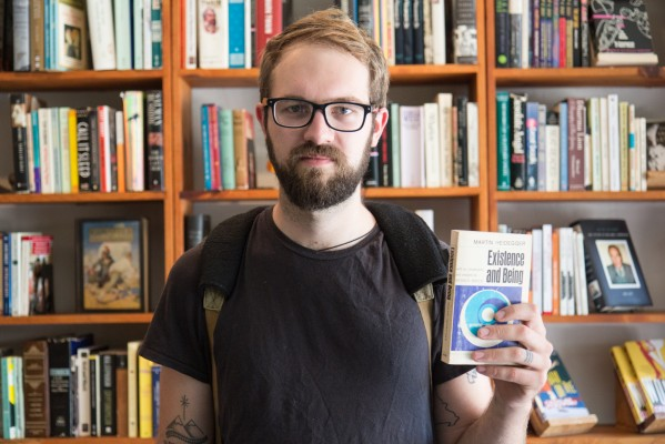 """Ian Flowers, one the first customers of the day, displays his copy of Heidegger's """"Existence And Being."""""""