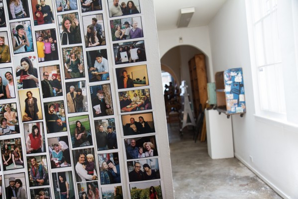 A wall decorated with photos memorializes the old Adobe Books.