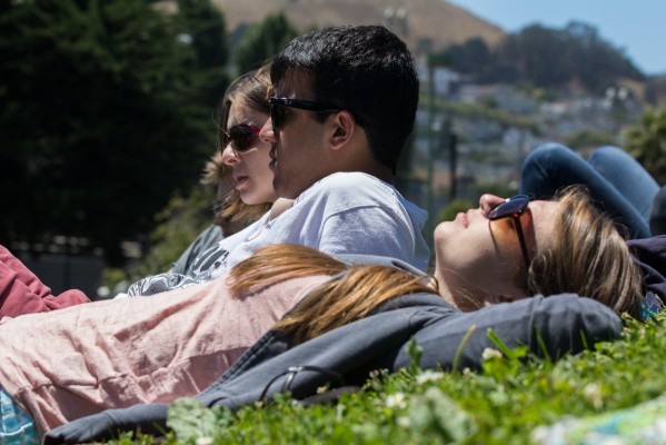 A woman relaxes on the grass during a show at Potrero del Sol Park.