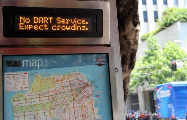 A sign at a Mission Street bus stop warns commuters about crowding during the July 2013 BART strike.