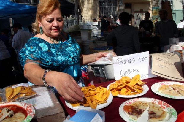 Maria del Carmen shows off her Salvadoran dishes at last year's Street Food Festival. Photo by Jamie Goldberg
