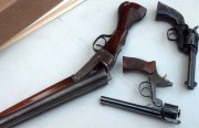 Three guns that were turned in at Thursday night's gun buyback.