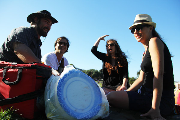 """From left to right, San Francisco locals Patrick McGuire, Diego Lozano, Frances Brady and Osana Avanesova talk about trash in Dolores park. """"Compared to what happens in Spain, this place is a haven,"""" Lozano said."""