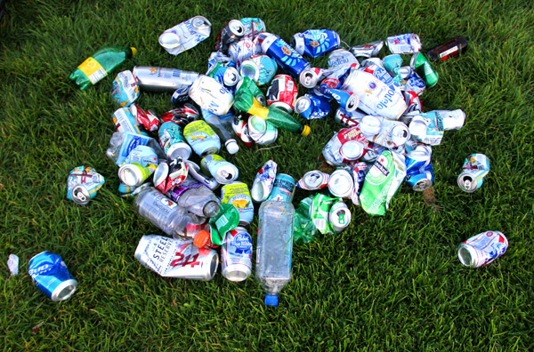 """A pile of plastic bottles and cans sits on the ground in Dolores Park. """"I think it's mostly drunk people that leave the trash,"""" said Eric Ingersoll, a 30-year-old East Bay resident who sells coffee and tea to park-goers on the weekends. """"It's not intentional. Everyone else throws away their trash or leaves cups and..."""