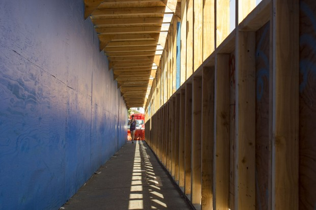Jogging down a construction scaffold on Mission street. Photo by Sarah McClure.