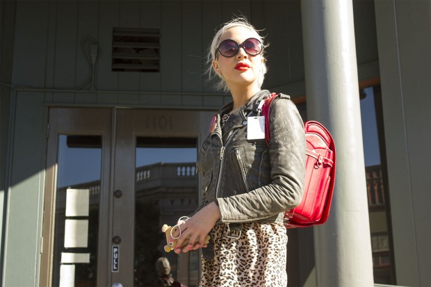 """En route to her hairdresser, Trista Winn, 30, was carrying hair extensions in her bag (bought in Japan.) """"I'm adding length and coloring my hair mint today,"""" she said. She was wearing NARS lipstick, a leopard skirt from Target's kids section and a pleather jacket from London."""