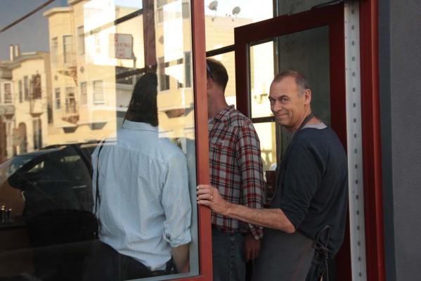 Andrew Barnett in the doorway of Linea Caffe.