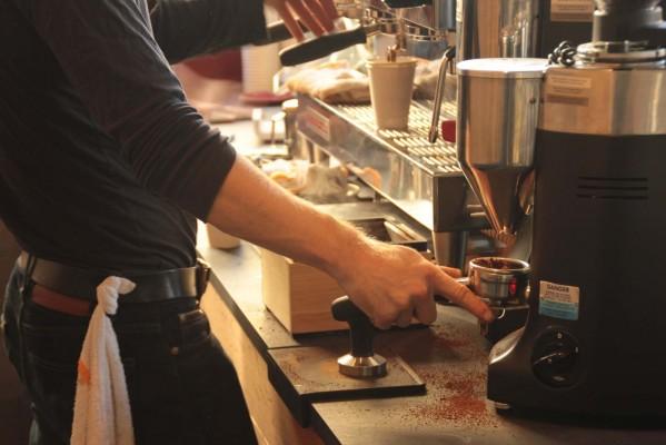 Barista Tom Baker prepares a coffee order.