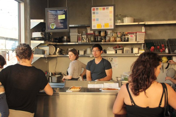 Anthony Myint mans the counter at Lt. Waffle/GreenSalads.org inside Linea Caffe.