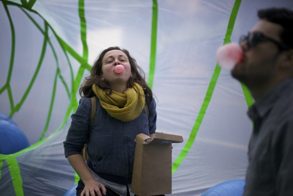 "Sarah Sobel blows bubble gum in ""Parkilicious,"" a temporary park built for Park(ing) Day."