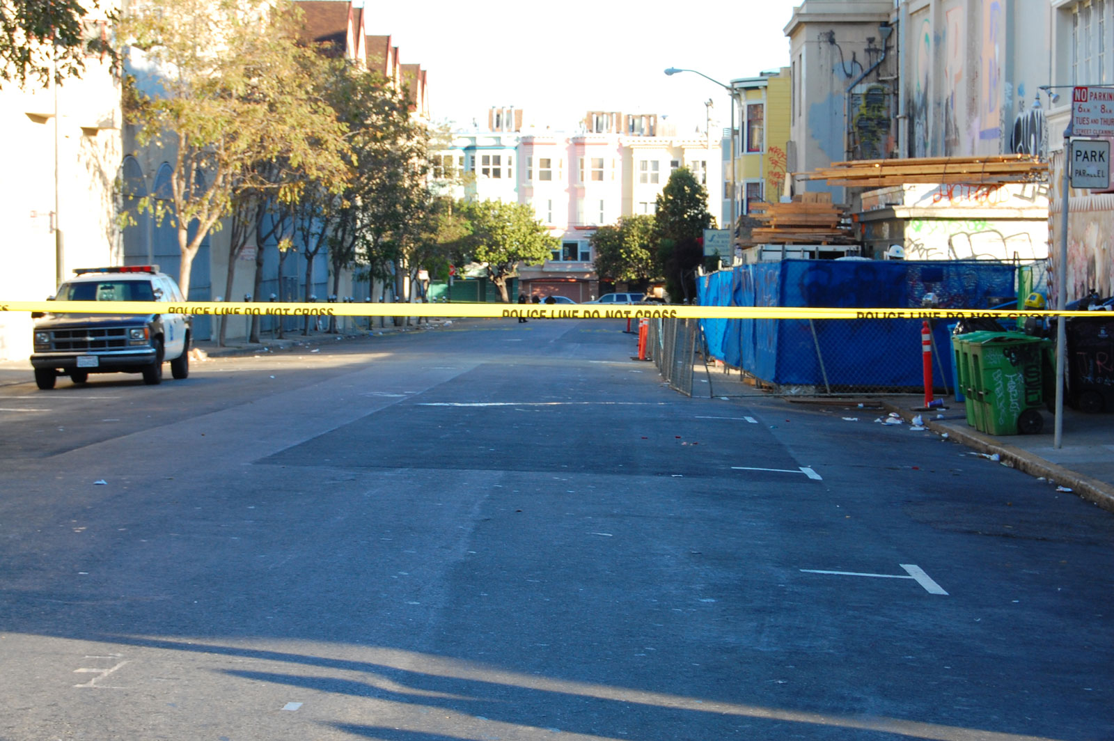 The unidentified man died in the middle on the road just beyond the police tape. Photo by Andra Cernavskis