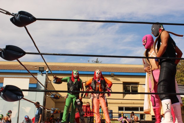 Lucha Libre wrestling teams ramp up for an epic battle at the Marshall Elementary fundraiser on Oct. 6. Photo by Heather Mack.